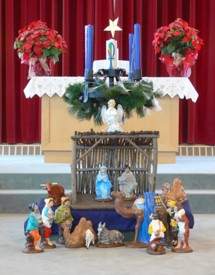 The nativity scene decorates the front of the church.