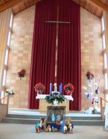 What a beautiful tribute to the Christmas season and a warm and inviting front of our sanctuary.