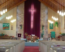 Our sanctuary, decorated for thanksgiving, showcases the beauty of the cross.